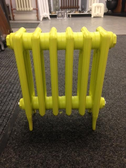Victorian cast iron radiator finished in farrow and Ball Yellowcake paint colour