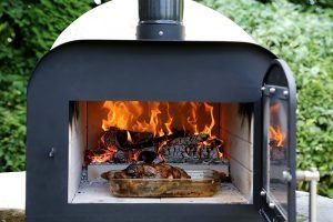 ESSE-Fire-Stone-roasting-a-chicken
